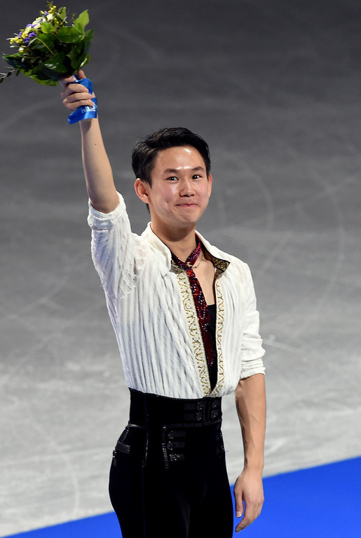 . Kazakhstan\'s bronze medalist Denis Ten celebrates during the Men\'s Figure Skating Flower Ceremony at the Iceberg Skating Palace during the Sochi Winter Olympics on February 14, 2014. (DAMIEN MEYER/AFP/Getty Images)