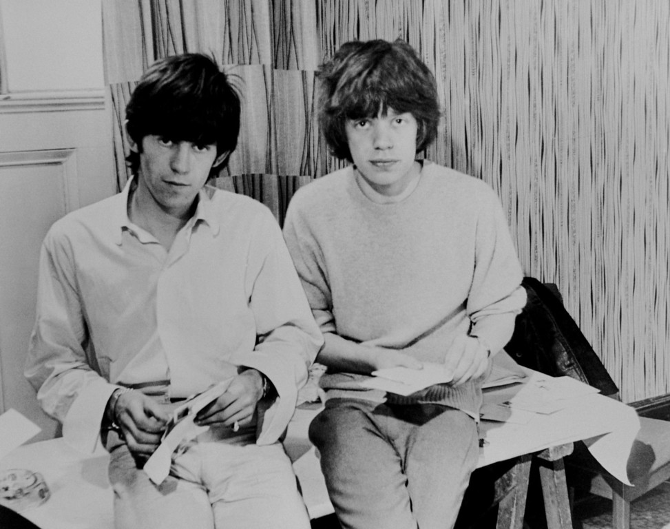 . Rolling Stones singer Mick Jagger and guitarist Keith Richards opening fan mail during the early days of the band, circa 1963. (Photo by Keystone Features/Hulton Archive/Getty Images)