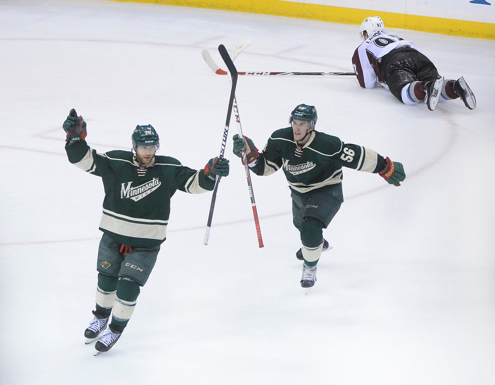 . Minnesota wing Jason Pominville, left, and Erik Haula, center, celebrated the first empty net goal late in the third period. The Minnesota Wild defeated the Colorado Avalanche 5-2 Monday night, April 28, 2014 at the Xcel Energy Center in St. Paul. (Photo by Karl Gehring/The Denver Post)