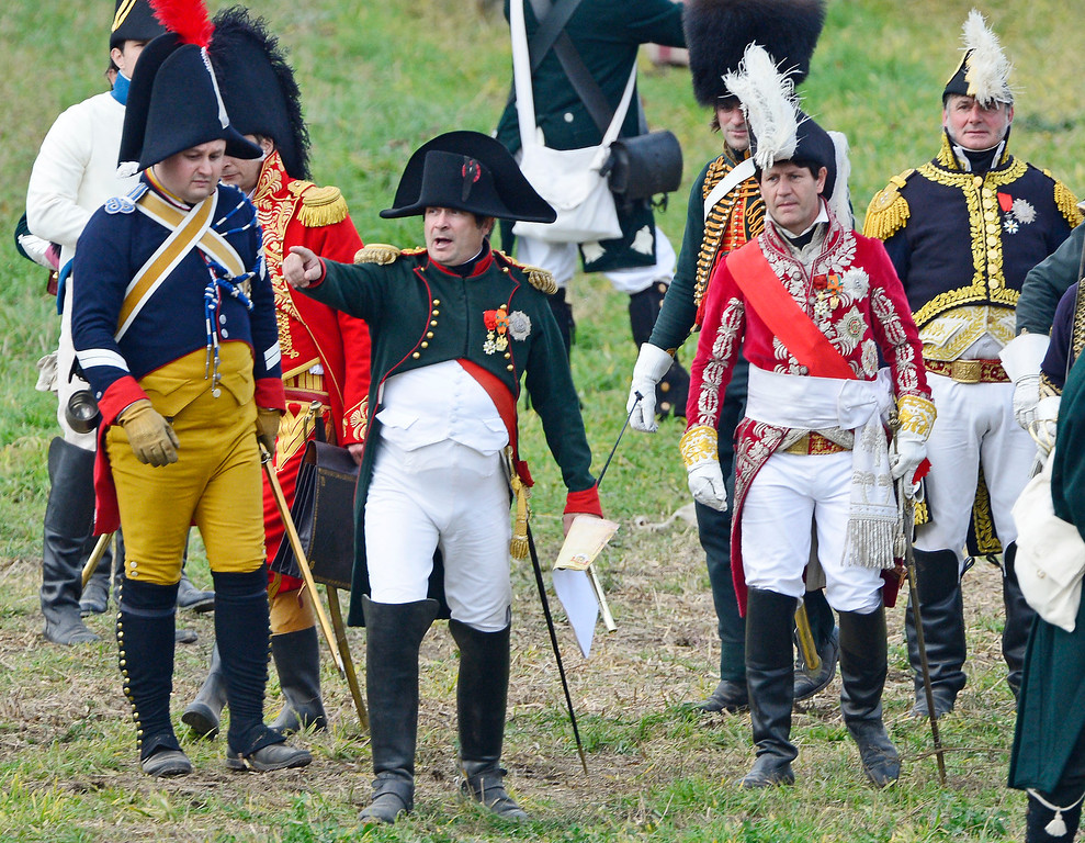 . French actor Franck Samson in the role of Napoleon, third left, gestures during the reconstruction of the Battle of the Nations at the 200th anniversary near Leipzig, central Germany, Sunday, Oct. 20, 2013. (AP Photo/Jens Meyer)
