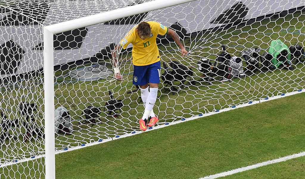 . Brazil\'s forward Neymar reacts after missing a goal opportunity during a Group A football match between Brazil and Mexico in the Castelao Stadium in Fortaleza during the 2014 FIFA World Cup on June 17, 2014. FRANCOIS XAVIER MARIT/AFP/Getty Images