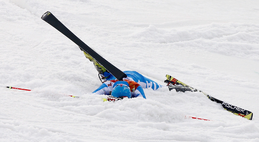 . Italy\'s Patrick Thaler crashes in the first run of the men\'s slalom at the Sochi 2014 Winter Olympics, Saturday, Feb. 22, 2014, in Krasnaya Polyana, Russia. (AP Photo/Christophe Ena)