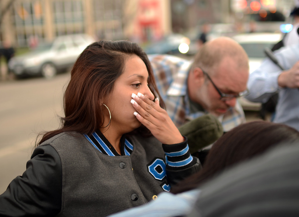 . DENVER, CO. - APRIL 20 : Friend of victims cry at the shooting site. Two people were shot in Denver\'s Civic Center during Saturday\'s pot rally, according to paramedics on the scene. Denver, Colorado. April 20, 2013. (Photo By Hyoung Chang/The Denver Post)