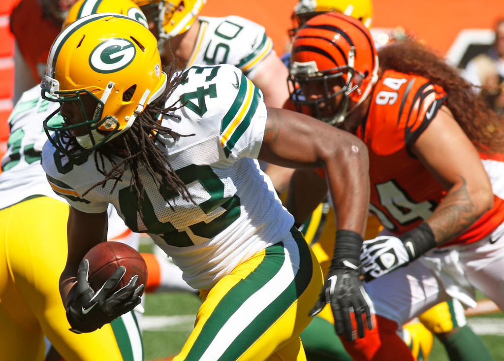 . Green Bay Packers free safety M.D. Jennings (43) returns a fumble 24-yards for a touchdown in the first half of an NFL football game against the Cincinnati Bengals, Sunday, Sept. 22, 2013, in Cincinnati. (AP Photo/David Kohl)