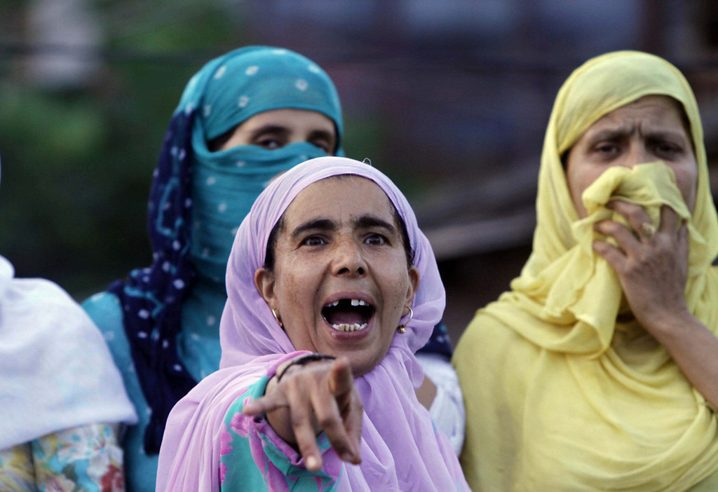 . A Kashmiri woman shouts slogans during a protest after paramilitary troops fired on a civilian when he allegedly failed to stop the car he was driving at a police barricade in Srinagar, India, Saturday, Sept. 7, 2013. A protest erupted Saturday after Indian police said they killed two alleged militants and two civilians in the disputed Himalayan territory of Kashmir, while authorities maintained tight security for a classical music concert being staged amid separatist objections. The driver was hospitalized in critical condition. (AP Photo/Mukhtar Khan)