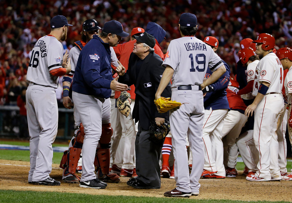 . Boston Red Sox manager John Farrell argues with home plate umpire Dana DeMuth after St. Louis Cardinals scored the winning run on an obstruction play during the ninth inning of Game 3 of baseball\'s World Series Saturday, Oct. 26, 2013, in St. Louis. The Cardinals won 5-4 to take a 2-1 lead in the series. (AP Photo/Matt Slocum)