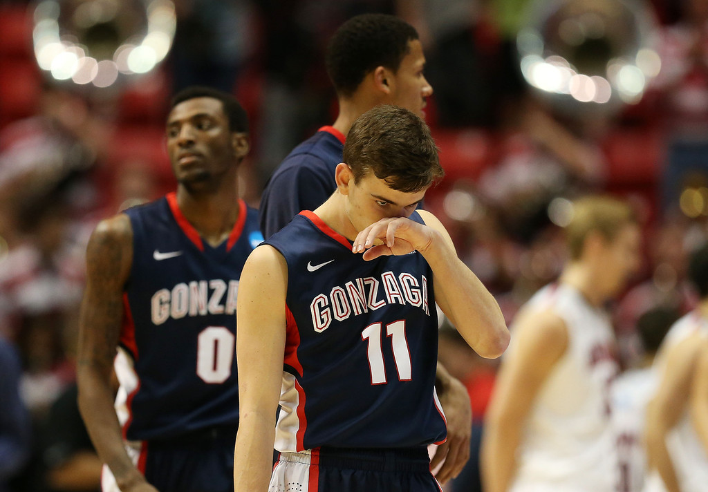 . David Stockton #11 of the Gonzaga Bulldogs reacts after their 84 to 61 loss to the against the Arizona Wildcats during the third round of the 2014 NCAA Men\'s Basketball Tournament at Viejas Arena on March 23, 2014 in San Diego, California.  (Photo by Jeff Gross/Getty Images)