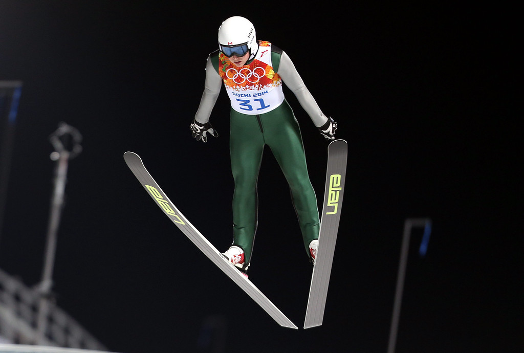 . Mackenzie Boyd-Clowes of Canada during the trial jump round in the Normal Hill qualification of the Ski Jumping competition at the Russki Gorki Jumping Centre at the Sochi 2014 Olympic Games, Krasnaya Polyana, Russia, 08 February 2014.  EPA/FEHIM DEMIR