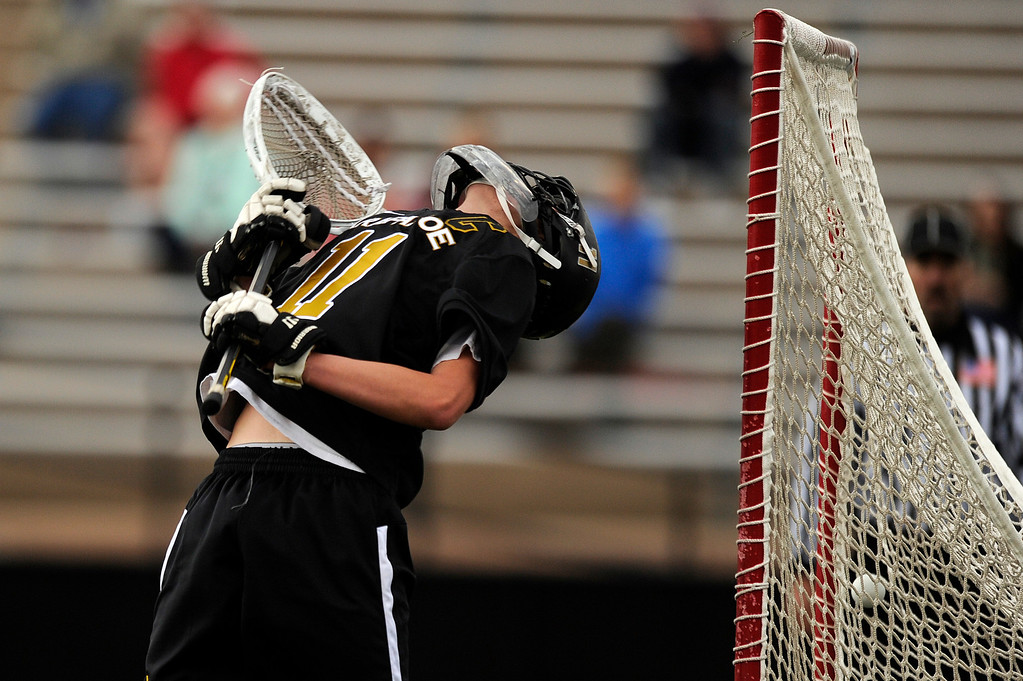 . DENVER, CO - MAY 15: Arapahoe senior goalie Ryan Smith #11 lets a goal go by against Regis Jesuit during a CHSAA 5A boys lacrosse semifinal game on May 15, 2013, in Denver, Colorado. Arapahoe won 13-5 to advance to the finals. (Photo by Daniel Petty/The Denver Post)