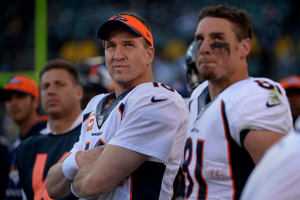 . Quarterback Peyton Manning (18) of the Denver Broncos on the sidelines during the second half vs the Oakland Raiders at O.co Coliseum December 29, 2013 Oakland, Calif. (Photo By Joe Amon/The Denver Post)