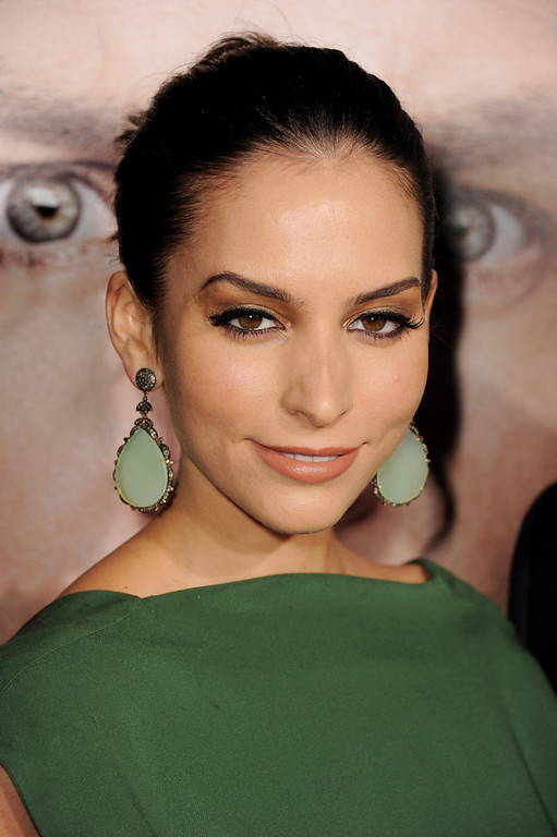 ". Actress Genesis Rodriguez arrives at the premiere of Universal Pictures\' ""Identity Theft\"" at the Village Theatre on February 4, 2013 in Los Angeles, California.  (Photo by Kevin Winter/Getty Images)"