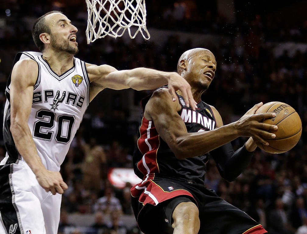 . Miami Heat\'s Ray Allen (34) tries to shoot against San Antonio Spurs\' Manu Ginobili (20), of Argentina, during the second half at Game 5 of the NBA Finals basketball series, Sunday, June 16, 2013, in San Antonio. The San Antonio Spurs won 114-104. (AP Photo/Eric Gay)