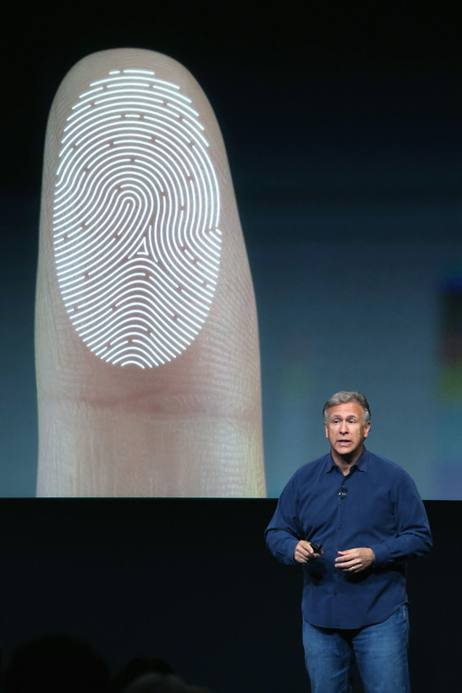 . Apple Senior Vice President of Worldwide Marketing Phil Schiller speaks about security features of the new iPhone 5S during an Apple product announcement at the Apple campus on September 10, 2013 in Cupertino, California. (Photo by Justin Sullivan/Getty Images)