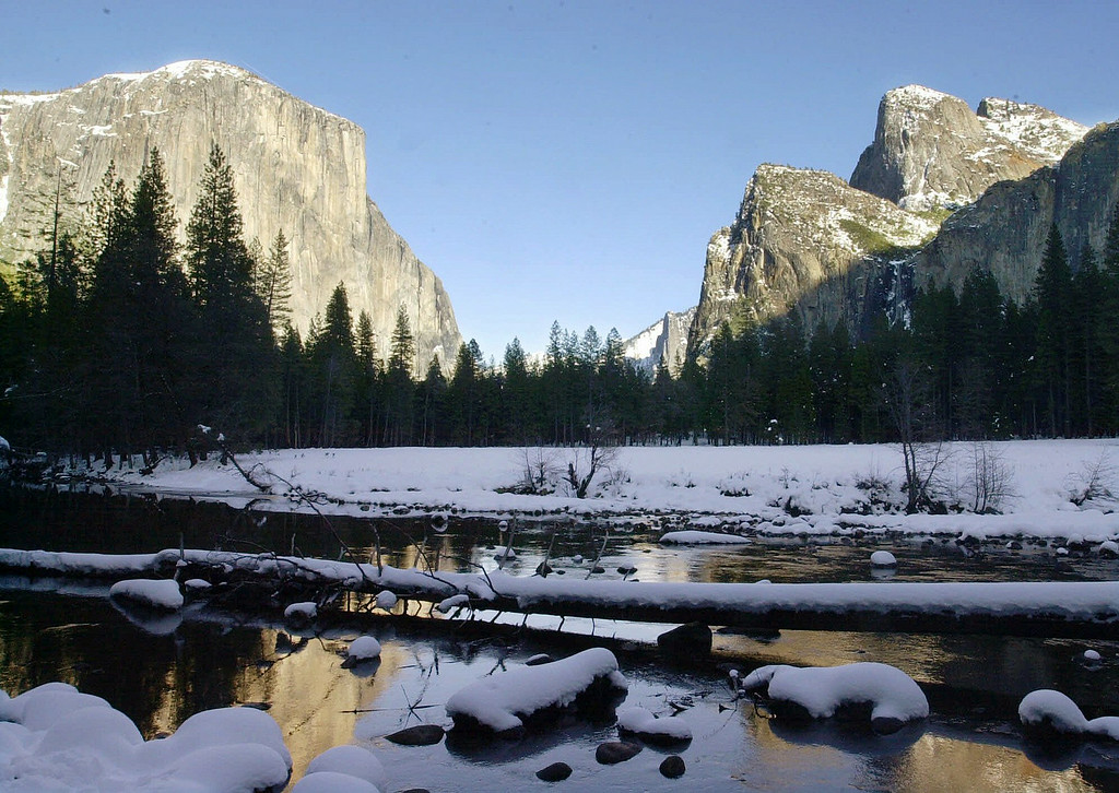 . The Yosemite Valley floor from the Merced River with El Capitan, left, and Glacier Point at right, is shown Jan. 31, 2001, in Yosemite, Calif.  (AP Photo/Paul Sakuma)