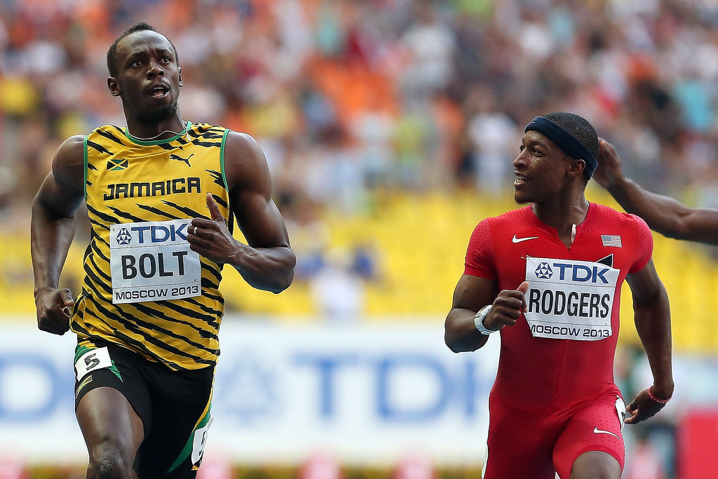 . Usain Bolt of Jamaica and Mike Rodgers of the United States compete in the Men\'s 100 metres semi final during Day Two of the 14th IAAF World Athletics Championships Moscow 2013 at Luzhniki Stadium on August 11, 2013 in Moscow, Russia.  (Photo by Ian Walton/Getty Images)