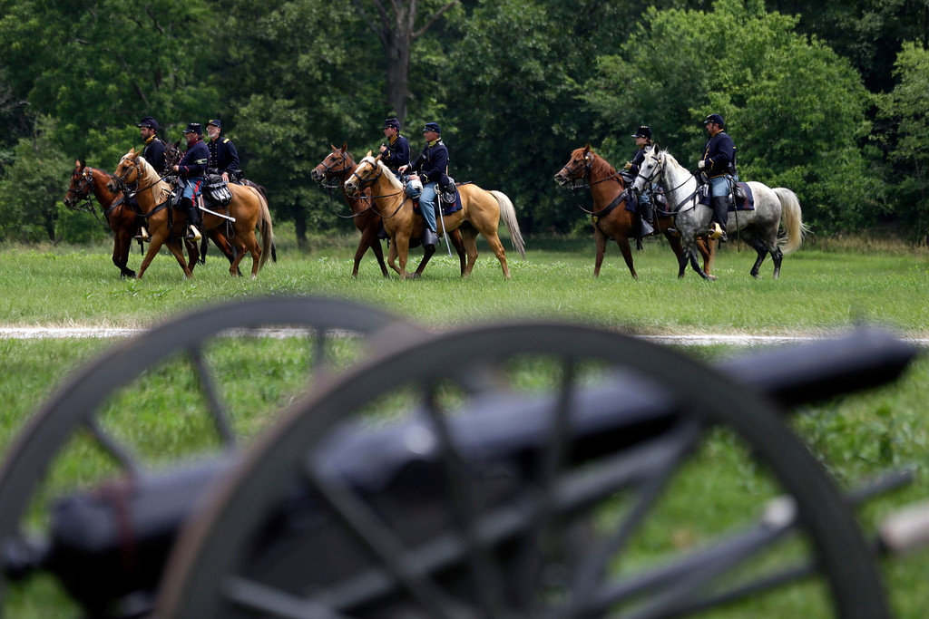 . Mounted Union reenactors drill during ongoing activities commemorating the 150th anniversary of the Battle of Gettysburg, Thursday, June 27, 2013, in Gettysburg, Pa.  Union forces turned away a Confederate advance in the pivotal battle of the Civil War fought July 1-3, 1863, which was also the warís bloodiest conflict with more than 51,000 casualties. (AP Photo/Matt Rourke)