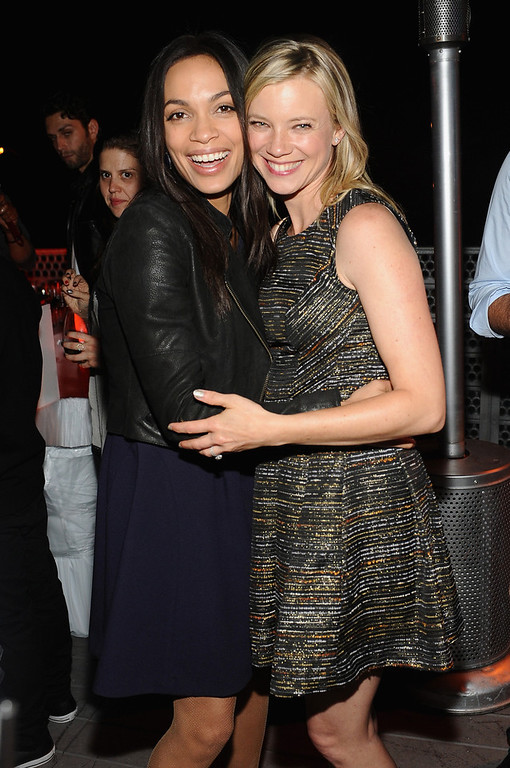 . Actresses Rosario Dawson and Amy Smart attends Coach\'s 3rd Annual Evening of Cocktails and Shopping to Benefit the Children\'s Defense Fund hosted by Katie McGrath, J.J. Abrams and Bryan Burk at Bad Robot on April 10, 2013 in Santa Monica, California.  (Photo by Stefanie Keenan/Getty Images for Coach)