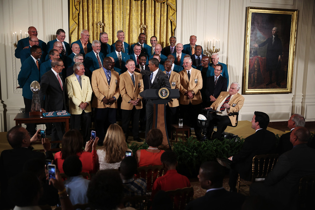 . WASHINGTON, DC - AUGUST 20:  U.S. President Barack Obama shares a moment with quarterback Bob Griese as Obama hosts members of the 1972 Miami Dolphins during an East Room event August 20, 2013 at the White House in Washington, DC. President Obama hosted the undefeated 1972 Super Bowl champion who didnt get the chance to be honored at the White House back then.  (Photo by Alex Wong/Getty Images)