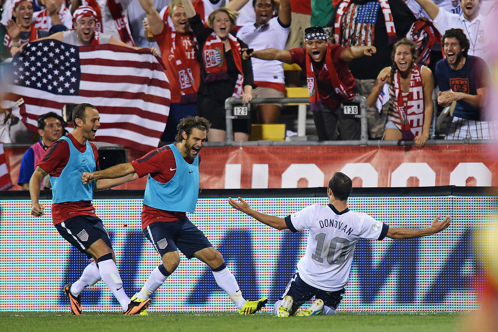 . Landon Donovan #10 of the United States Men\'s National Team celebrates his second half goal against Mexico with teammates Brad Davis #17 of the United States Men�s National Team, far left, and Graham Zusi #19 of the United States Men�s National Team, middle, at Columbus Crew Stadium on September 10, 2013 in Columbus, Ohio. The United States defeated Mexico 2-0.  (Photo by Jamie Sabau/Getty Images)