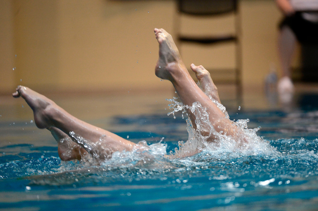 . THORNTON, CO. - MARCH 10: Cincinnati Synchrogators duet team Rachel Handleton and Jack Justice perform during the duet free at The Rocky Mountain Synchronized Swimming North Zones Championships  March 10, 2013 at Veterans Memorial Aquatic Center. (Photo By John Leyba/The Denver Post)