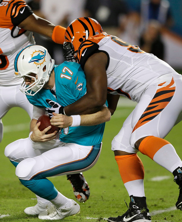 . Miami Dolphins quarterback Ryan Tannehill (17) is sacked by Cincinnati Bengals defensive tackle Geno Atkins during the first half of an NFL football game, Thursday, Oct. 31, 2013, in Miami Gardens, Fla. (AP Photo/Wilfredo Lee)