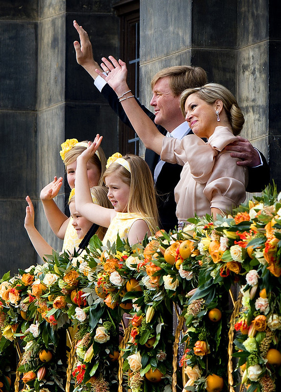 . King Willem-Alexander of the Netherlands, his wife Queen Maxima (R) and their children Catharina-Amalia, Princess of Orange (front, L), Princess Ariane (front, R) and Princess Alexia (C) wave on April 30, 2013 to the crowd gathered on Dam Square from the balcony of the Royal Palace in Amsterdam, following the official abdication of Queen Beatrix of the Netherlands. ROBIN UTRECHT/AFP/Getty Images