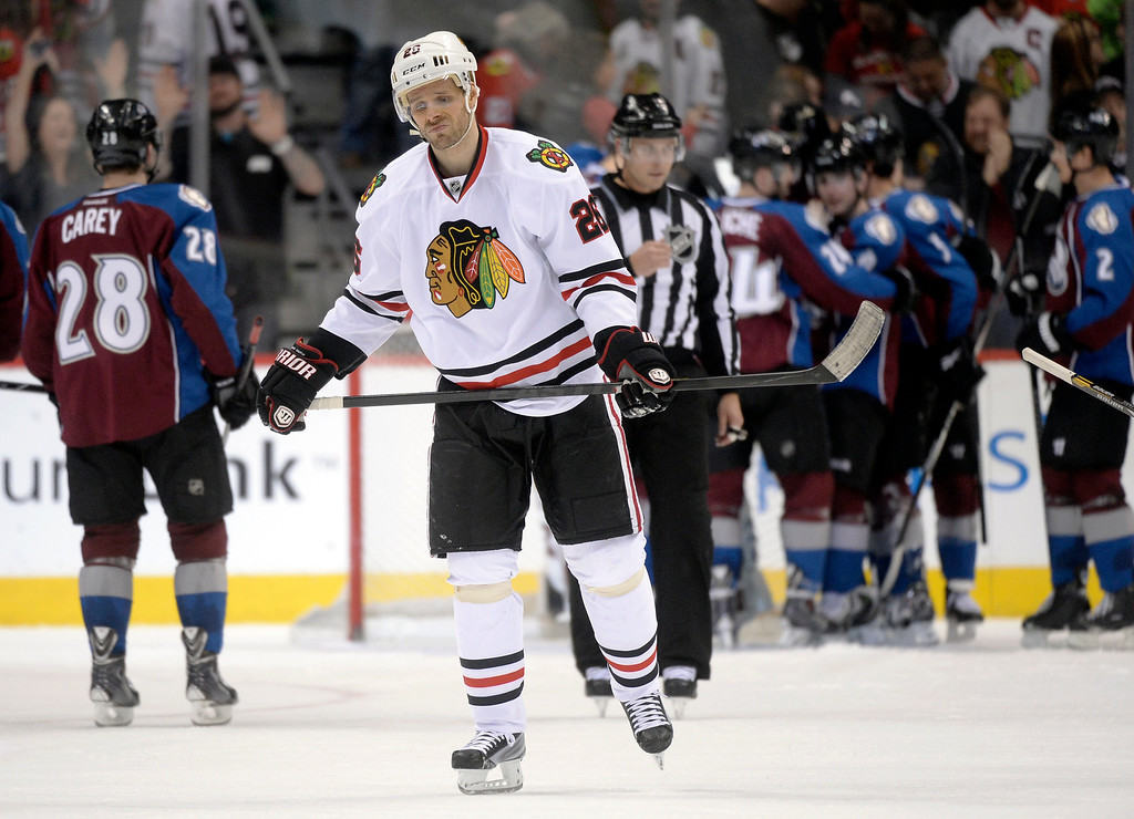 . Chicago wing Ben Smith (28) skated off the ice following the final buzzer.   (Photo by Karl Gehring/The Denver Post)
