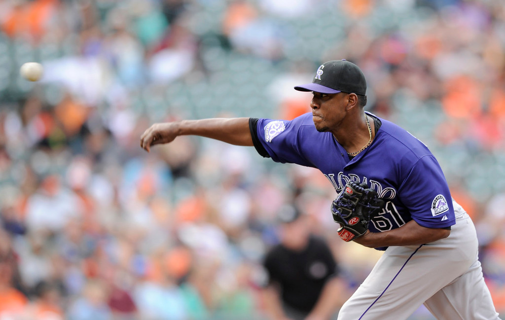 . Colorado Rockies relief pitcher Edgmer Escalona delivers  against the Baltimore Orioles during the eighth inning of a baseball game on Sunday, Aug. 18, 2013, in Baltimore. The Orioles won 7-2. (AP Photo/Nick Wass)