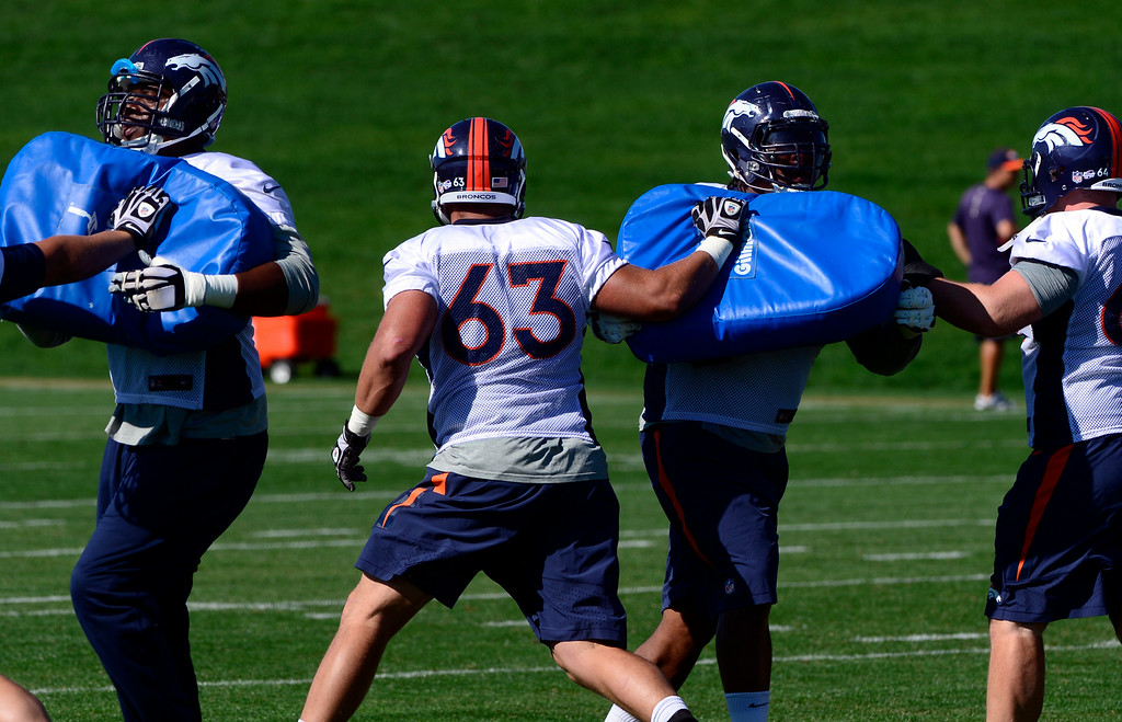 . Offensive players run through drills at the start of practice. The Denver Broncos football team gets in their final day of practice during training camp at Dove Valley  on Friday, Aug. 15, 2014. (Photo by Kathryn Scott Osler/The Denver Post)