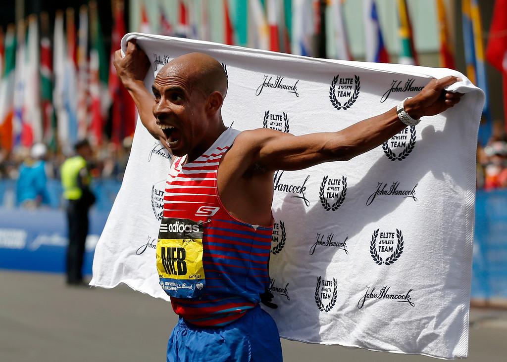 . Meb Keflezighi, of San Diego, Calif., celebrates after winning the 118th Boston Marathon, Monday, April 21, 2014, in Boston. (AP Photo/Elise Amendola)