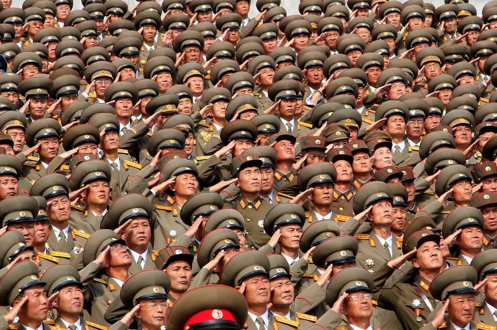 . North Korean soldiers salute during a military parade at Kim Il Sung Square to mark the 65th anniversary of the country\'s founding in Pyongyang, North Korea, Monday, Sept. 9, 2013. (AP Photo/Kim Kwang Hyon)