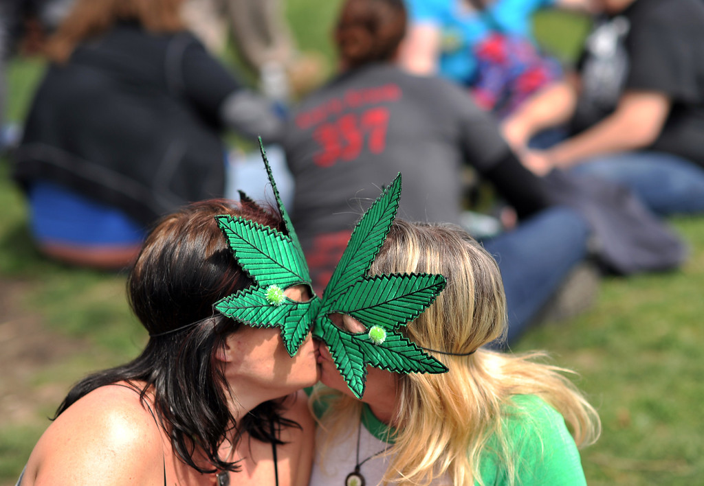 . DENVER, CO. - APRIL 20 : Amy McBain of Evergreen, left, and Kim Logsdon of Denver celebrate 4/20 at Civic Center Park in Denver. A crowd of marijuana smokers gathered at the park to mark the counterculture holiday known as 4/20 on the first celebration since Colorado and Washington made pot legal for recreation use. (Photo By Hyoung Chang/The Denver Post)