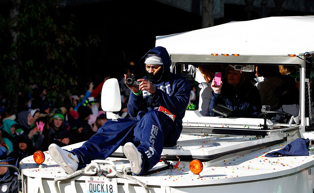. Marshawn Lynch #24 of Seattle Seahawks celebrates shoots video during a parade to celebrate their  victory in Super Bowl XLVII on February 5, 2014 in Seattle, Washington.  (Photo by Jonathan Ferrey/Getty Images)