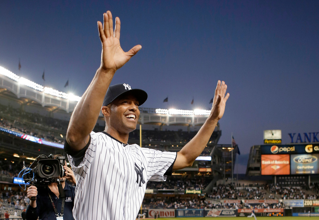 . New York Yankees relief pitcher Mariano Rivera acknowledges fans after receiving gifts prior to his final appearance at Yankee Stadium, for a baseball game against the Tampa Bay Rays on Thursday, Sept. 26, 2013, in New York. Rivera is retiring at the end of the season. (AP Photo/Kathy Willens)