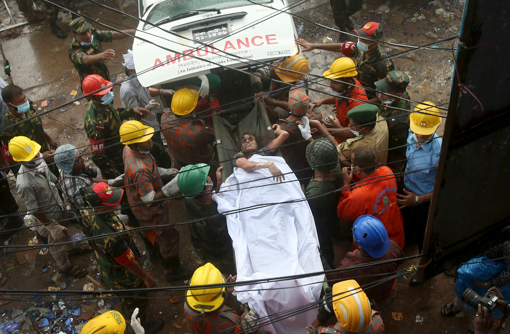 . A survivor is carried on a stretcher into a waiting ambulance after being evacuated from a garment factory building that collapsed Wednesday in Savar, near Dhaka, Bangladesh, Saturday, April 27, 2013. Police in Bangladesh took five people into custody in connection with the collapse of a shoddily-constructed building this week, as rescue workers pulled 19 survivors out of the rubble on Saturday and vowed to continue as long as necessary to find others despite fading hopes.(AP Photo/Wong Maye-E)