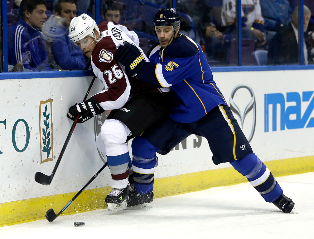 . Colorado Avalanche\'s Paul Stastny, left, and St. Louis Blues\' Barret Jackman chase after a loose puck during the first period of an NHL hockey game Thursday, Nov. 14, 2013, in St. Louis. (AP Photo/Jeff Roberson)