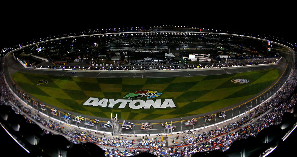 . Trucks take the green flag to start the NASCAR Camping World Truck Series NextEra Energy Resources 250 race at the Daytona International Speedway in Daytona Beach, Florida February 22, 2013. The Daytona 500 NASCAR Sprint Cup race is scheduled for February 24.   REUTERS/Pierre Ducharme