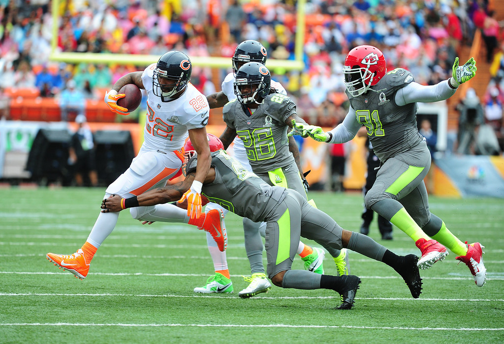 . Matt Forte #22 of the Chicago Bears and Team Rice carries the ball against Eric Berry #29 of Team Sanders during the 2014 Pro Bowl at Aloha Stadium on January 26, 2014 in Honolulu, Hawaii  (Photo by Scott Cunningham/Getty Images)