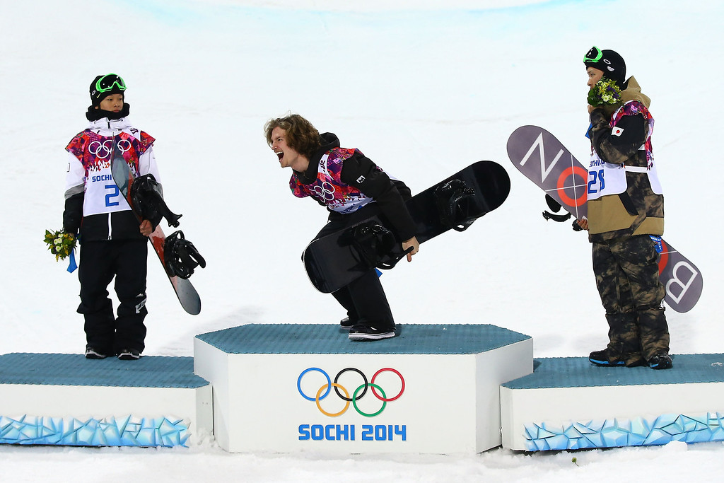 . (L-R) Silver medalist Ayumu Hirano of Japan, gold medalist Iouri Podladtchikov of Switzerland and bronze medalist Taku Hiraoka of Japan celebrate on the podium during the flower ceremony for the Snowboard Men\'s Halfpipe Finals on day four of the Sochi 2014 Winter Olympics at Rosa Khutor Extreme Park on February 11, 2014 in Sochi, Russia.  (Photo by Al Bello/Getty Images)