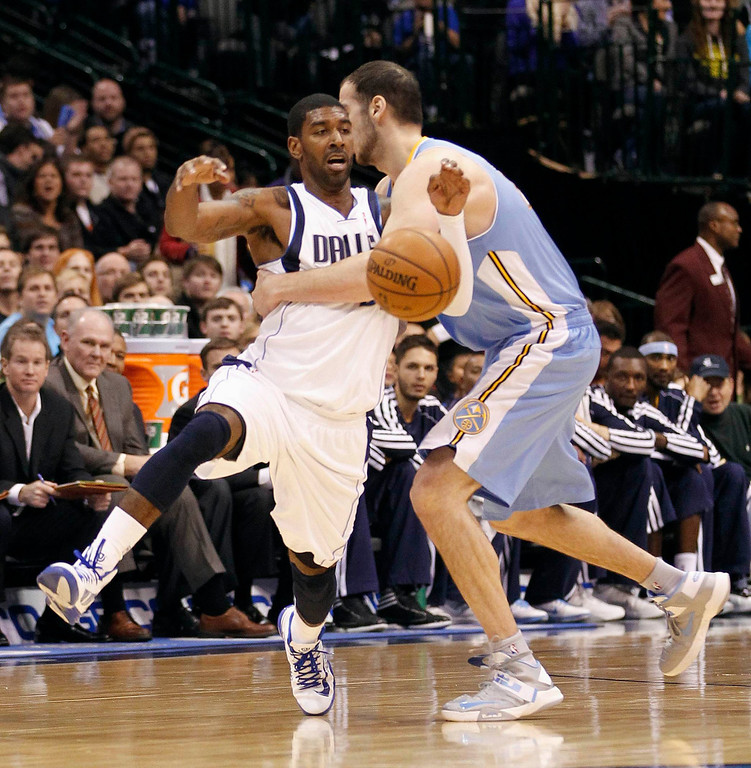. Dallas Mavericks guard O.J. Mayo is fouled by Denver Nuggets center Kosta Koufos during the first half of their NBA basketball game in Dallas, Texas December 28, 2012. REUTERS/Mike Stone