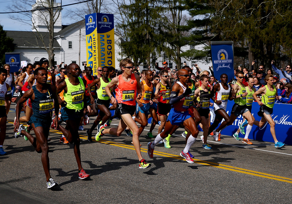 . The Elite Men\'s division starts the 118th Boston Marathon on April 21, 2014 in Hopkinton, Massachusetts.  (Photo by Alex Trautwig/Getty Images)