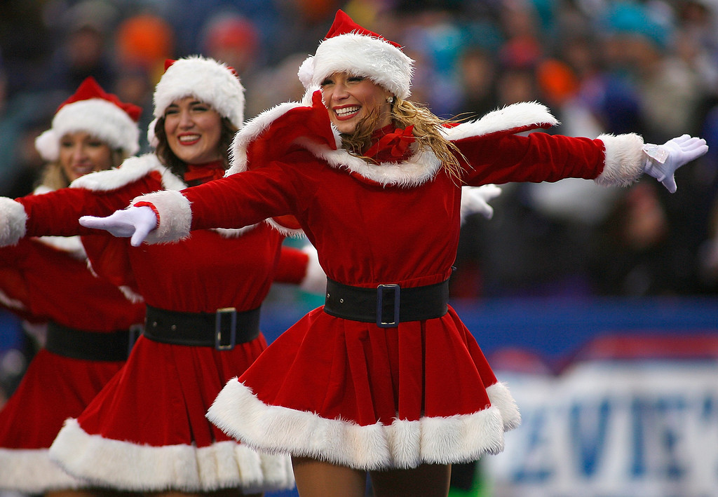 . Members of the Buffalo Jills dance squad perform during a timeout between the Buffalo Bills and Miami Dolphins at Ralph Wilson Stadium on December 22, 2013 in Orchard Park, New York. Buffalo won 16-0.  (Photo by Rick Stewart/Getty Images)