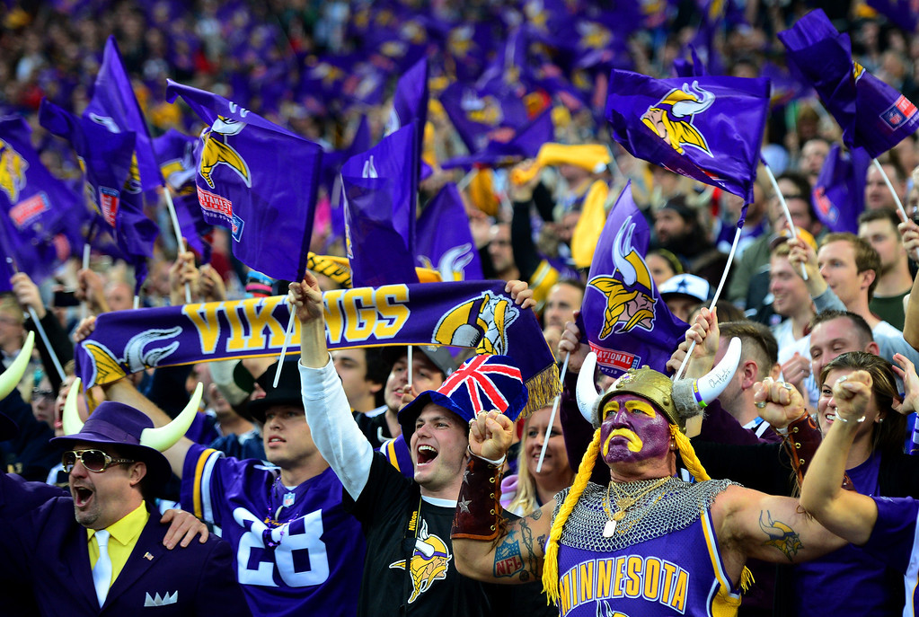 . LONDON, ENGLAND - SEPTEMBER 29:  Minnesota Vikings fans welcome their team prior to the NFL International Series game between Pittsburgh Steelers and Minnesota Vikings at Wembley Stadium on September 29, 2013 in London, England.  (Photo by Jamie McDonald/Getty Images)