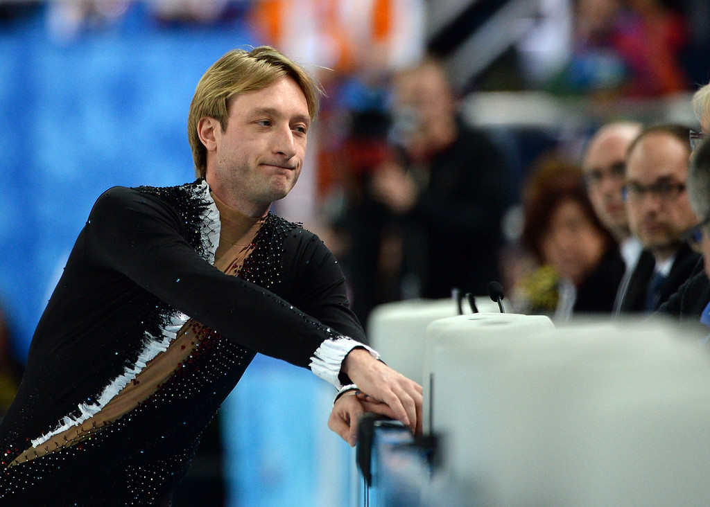 . Russia\'s Yevgeny Plushenko announces to the judges his withdrawal from the Men\'s Figure Skating Short Program at the Iceberg Skating Palace during the Sochi Winter Olympics on February 13, 2014. Two-time Olympic gold medalist Yvegeny Plushenko withdrew from the Sochi Olympics injured before competing in the men\'s figure skating short program today. JUNG YEON-JE/AFP/Getty Images