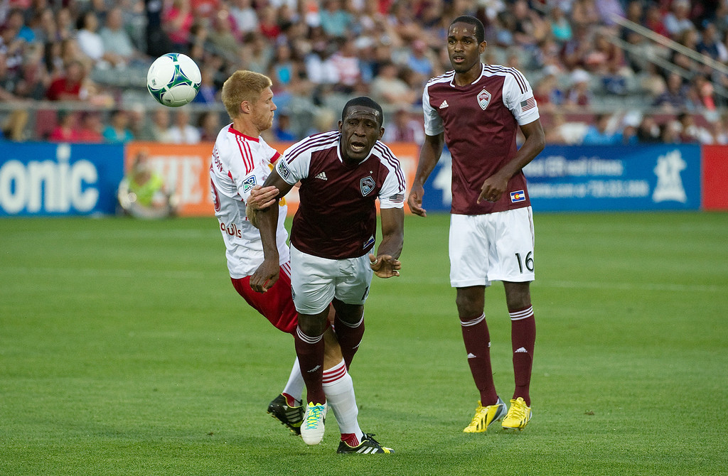 . DENVER - JULY 4: Hendry Thomas, #12 of the Colorado Rapids, falls after being blocked by Markus Holgersson, #5 of the New York Red Bulls, during the first half of a MLS soccer match against the New York Red Bulls on July 4, 2013 at Dick\'s Sporting Goods Park.(Photo By Grant Hindsley / The Denver Post)