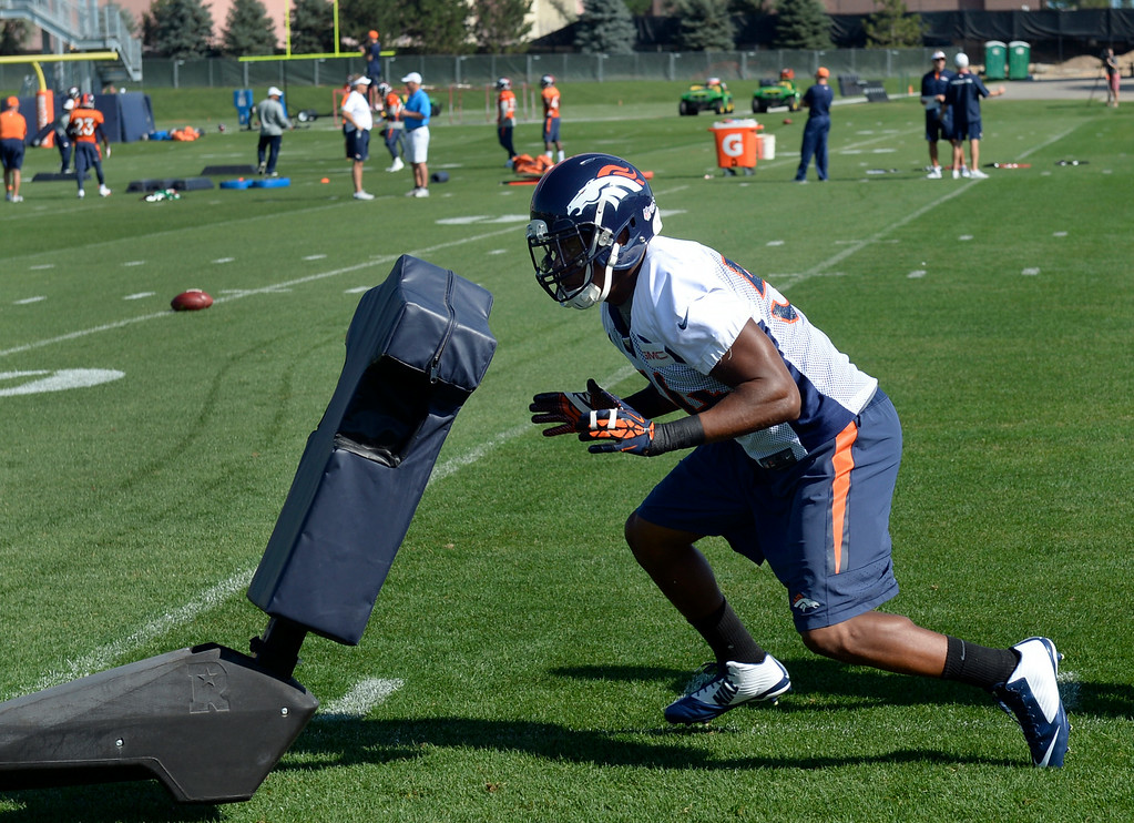 . Brandon Marshall (54) runs through drills with the rest of the linebackers. The Denver Broncos practice at Dove Valley on Monday, Sept. 1, 2014 in preparation for their season opener against the Indianapolis Colts on Sunday night. (Kathryn Scott Osler/The Denver Post)