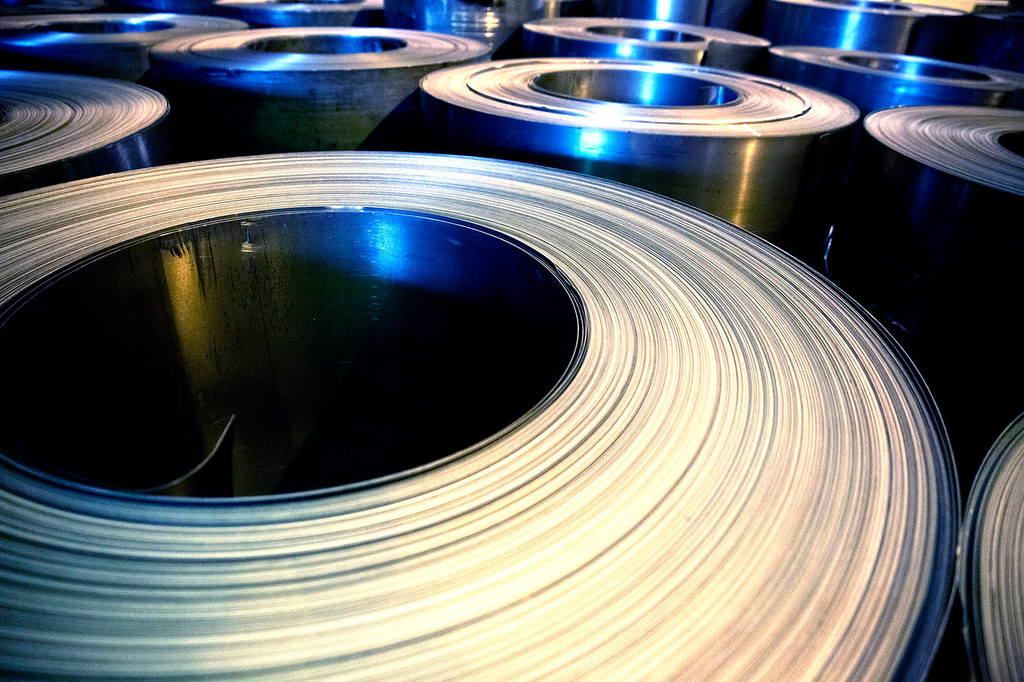 . Coils of flat rolled steel produced by the Zaporizhstal steel plant, owned and operated by Metinvest BV, are seen in the storage area at the site in Zaporizhzhya, Ukraine, on Tuesday, Oct. 15, 2013. Metinvest BV, Ukraine\'s largest steelmaker, last year acquired 49.9% in steelmaker Zaporizhstal a manufacturer of semi-finished steel products, including hot and cold-rolled plates and coils. Photographer: Vincent Mundy/Bloomberg