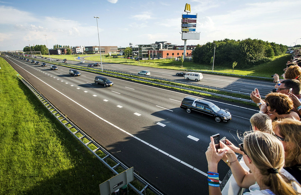 . Mourners line the route in Waardenburg as hearses carry the remains of the victims of the Malaysia Airlines flight MH17 plane crash from an airbase in Eindhoven to Hilversum, The Netherlands, on July 24, 2014, after a Dutch Air Force C-130 Hercules plane and an Australian Royal Australian Air Force C17 transporting the remains arrived from Kharkiv, Ukraine. Dozens more bodies from the crash site of Malaysia Airlines flight MH17 are set to arrive in the Netherlands on July 24, as the EU prepares to hit Russia with fresh sanctions. AFP PHOTO / ANP / REMKO DE WAAL/AFP/Getty Images