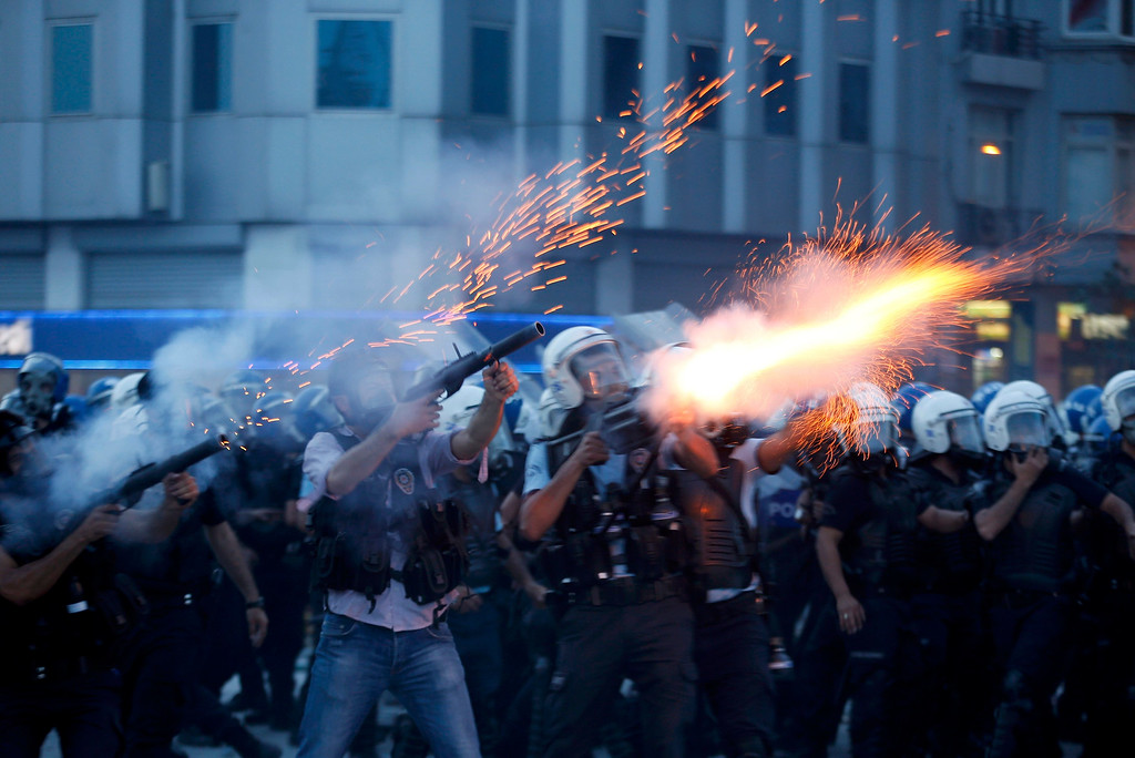 . Riot policemen fire teargas during a protest at Taksim Square in Istanbul June 11, 2013. REUTERS/Murad Sezer