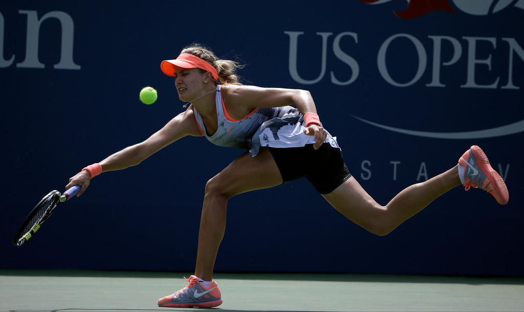 . Eugenie Bouchard, of Canada, returns a shot to Angelique Kerber, of Germany, during the second round of the 2013 U.S. Open tennis tournament, Thursday, Aug. 29, 2013, in New York. (AP Photo/David Goldman)